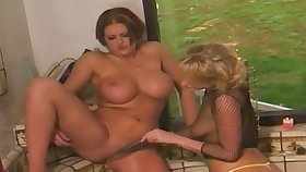 Outdoor lesbian toying with Mr Big matures